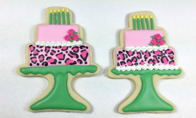 pink rose leopard layer cake cookies on pedestal